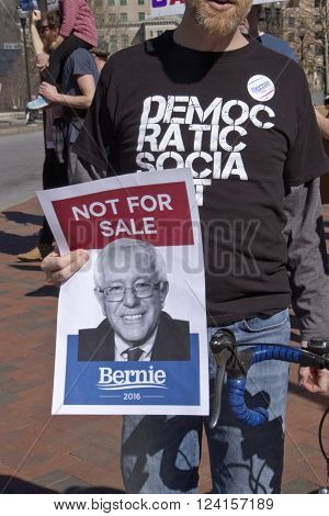 Asheville, North Carolina, USA - February 28, 2016: Bernie Sanders supporters hold signs and display Democratic Socialist t-shirts at a Sanders rally in downtown Asheville NC