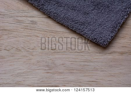 Microfiber Cloth on wooden background. Microfiber and wooden