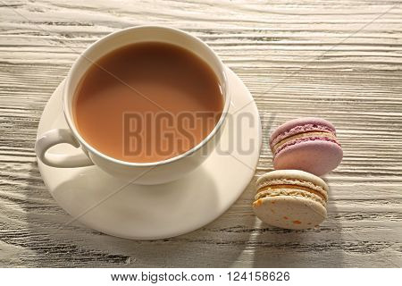 Milk tea with macarons on white background.