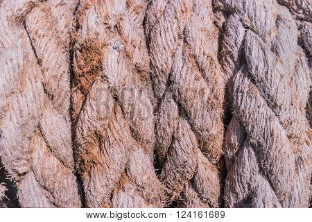 Close-up of an old frayed boat rope as a nautical background.