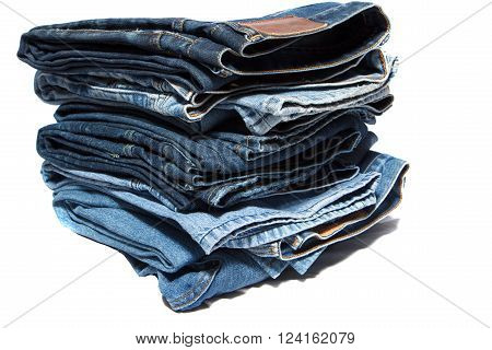stack with old jeans  on white background