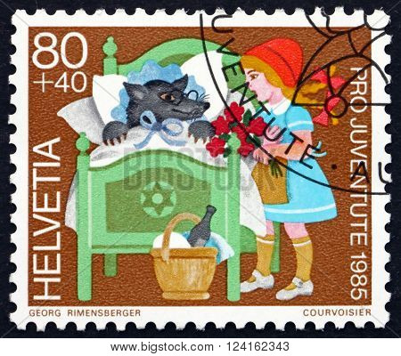 SWITZERLAND - CIRCA 1985: a stamp printed in the Switzerland shows Little Red Riding Hood Fairy Tale by Jakob and Wilhelm Grimm circa 1985