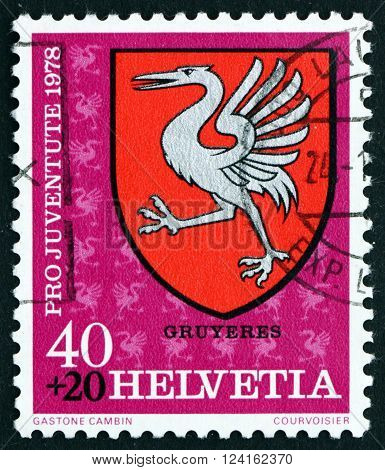 SWITZERLAND - CIRCA 1978: a stamp printed in the Switzerland shows Gruyeres Communal Arms circa 1978
