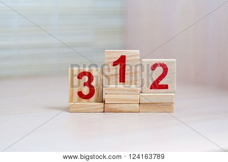Top places. First place. Wooden blocks with numbers