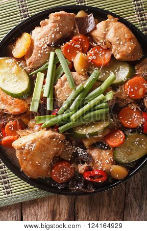 Korean Dakjim: chicken with vegetables close-up. Vertical top view