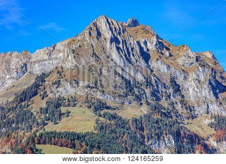 Mt. Scheideggstock in the Swiss Alps, view from the town of Engelberg in the Swiss canton of Obwalden in autumn.