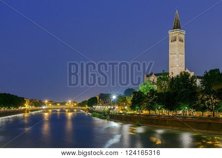 View of the Church of Santa Anastasia and the River Adige at night.