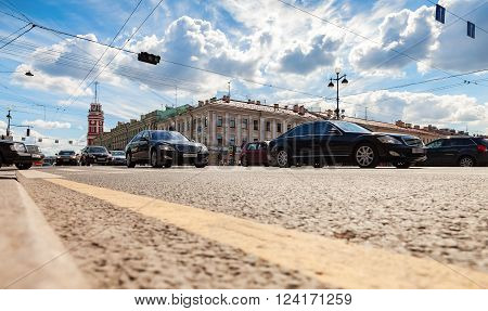 ST. PETERSBURG RUSSIA - AUGUST 5 2015: Road transport is moving along Nevsky Prospect in the summer sunny day