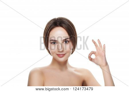 Pretty Girl With Natural Makeup Show Gesture Okey. Beautiful Spa Woman Touching Her Face. Perfect Fr