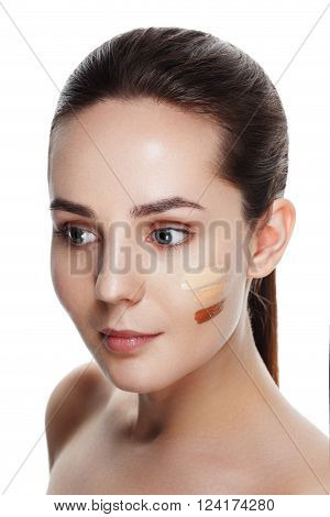 Beauty Girl Try To Different Tones Of Foundation Concealer. Natural Makeup For Brunette Woman With