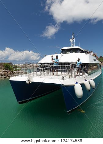 La Digue - November 10 2014: Ferry with tourists comes into the port of the island of La Digue on a sunny day November 10 2014 the island of La Digue Seychelles