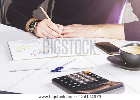 Man Drawing Business Scheme