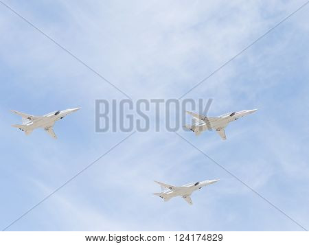 Moscow - 7 May 2015: Three Tu-22M for the codification of NATO: backfire supersonic bomber-missile in flight during a rehearsal for the Victory Parade in Moscow on May 7 2015 Moscow Russia