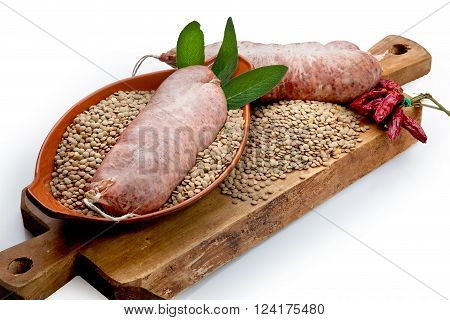 Composition of meat beef and pork with vegetables, lentils and pork sausage