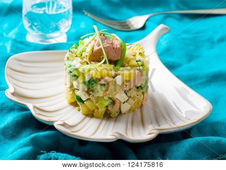 Salad with cod liver . selective focus