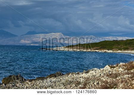 coast of island of Corfu with white rock