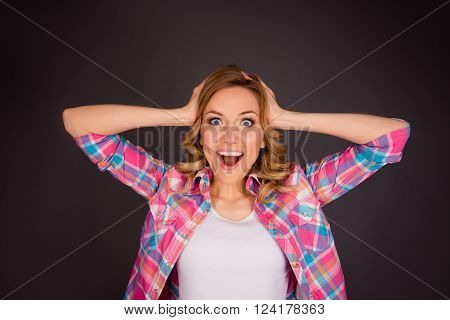 Surprised Happy Young Woman Touching Her Head And Screaming