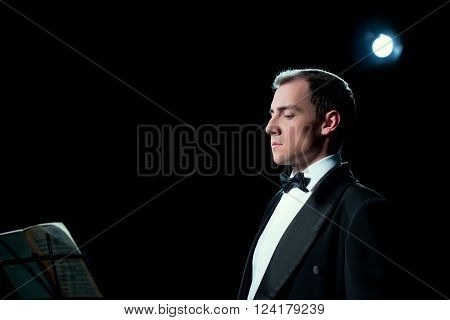 Studio photo of music conductor focused before the show