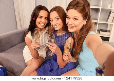 Beautiful Women Holding Glasses With Wine And Making Selfie