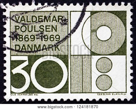 DENMARK - CIRCA 1969: a stamp printed in Denmark dedicated to Valdemar Poulsen Engineer and Inventor Symbolic Design circa 1969