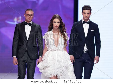 Sofia, Bulgaria - March 23, 2016: Models in suits and wedding dress walk the runway during the 2016 Sofia Fashion Week Show in Sofia, Bulgaria.
