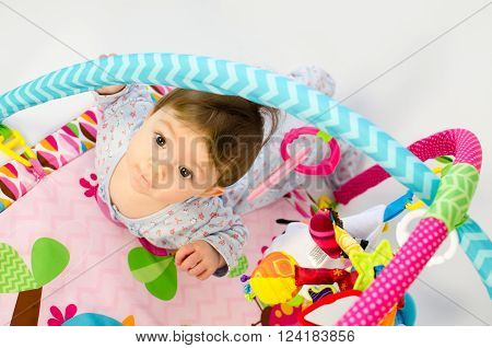 Baby Girl Palying In An Activity Gym