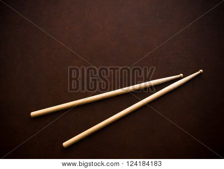 Couple Of Drum Sticks On Wooden Desktop
