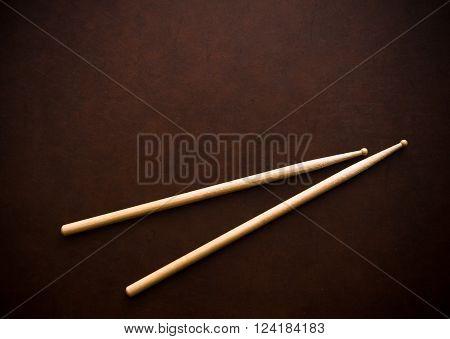 Couple Of Drum Sticks On Wooden Desktop