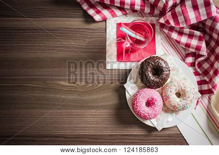 A plate with colourful donuts from above