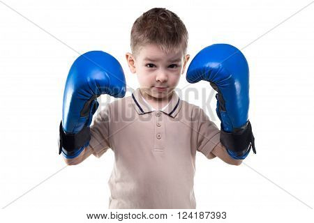Cute serious little boy with boxing gloves on white background