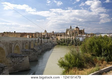 CORDOBA, SPAIN - September 10, 2015: View of the old city and Mosque-Cathedral of Cordoba seen from the south bank of the Guadalquivir river on September 10, 2015 in Cordoba, Spain