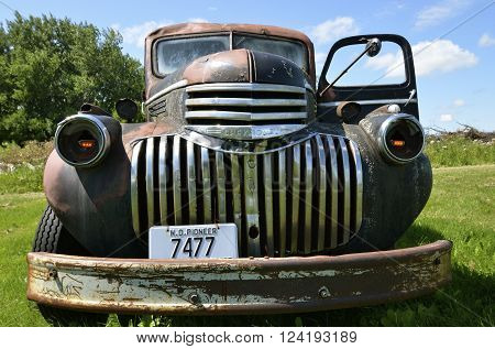 The old pickup from the 40's is a Chevrolet  colloquially referred to as Chevy and formally the Chevrolet Division of General Motors Company, is an American automobile division of the American manufacturer General Motors