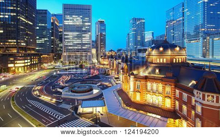 Tokyo railway station and Tokyo highrise building at twilight time