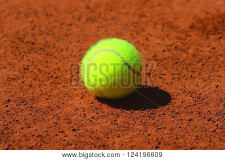 Tennis ball at red clay tennis court