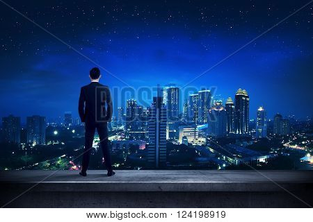 Asian Business Person Standing On The Rooftop