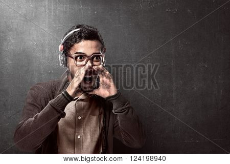 Asian Man Wearing Headphone And Shouting