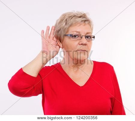 Elderly senior woman placing hand on ear, difficulty in hearing in old age, showing human emotions, facial expressions