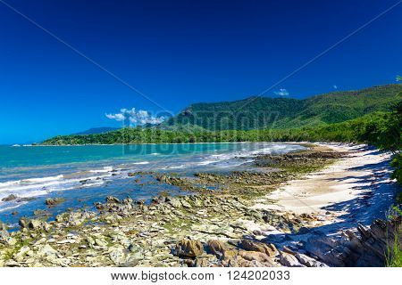 Ellis Beach with rocks near Palm Cove and Cairns, Australia