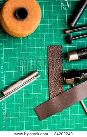 Leather Craft Tools On Green Cutter Board Background