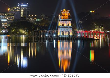 HANOI, VIETNAM - JANUARY 10, 2016: View of the Hoan Kiem lake and Turtle Tower. Night Hanoi. The historic landmark of the city of Hanoi, Vietnam