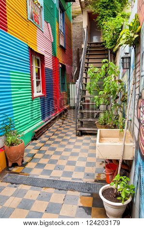 Buenos Aires Argentina - December 16 2012: La Boca - Typical colorful house stairs and facade in the famous district of Buenos Aires. Shot from the back alley to the building facade in Buenos Aires Argentina.