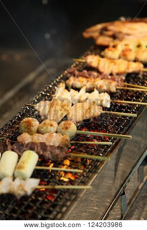 grilling traditional Japanese style chicken barbecue yakitori