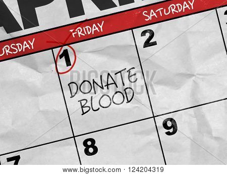 Concept image of a Calendar with the text: Donate Blood