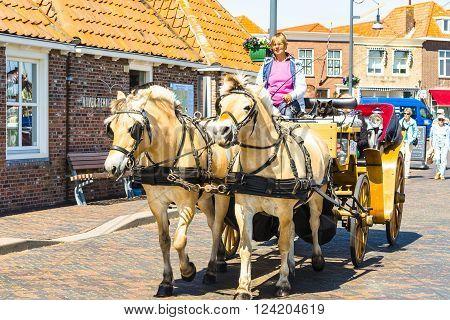 ZIERIKZEE ZEELAND NETHERLANDS - JUNE 15 2015: Carriage ride through the beautiful old port town of Zierikzee Zeeland in the Netherlands.
