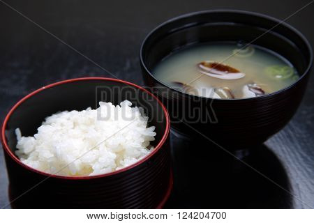 close up shot of boiled rice and miso soup