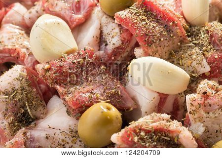 Marinade of lamb stew with herbes de Provence garlic and olives