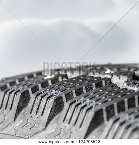Tread winter car tire with spikes close-up