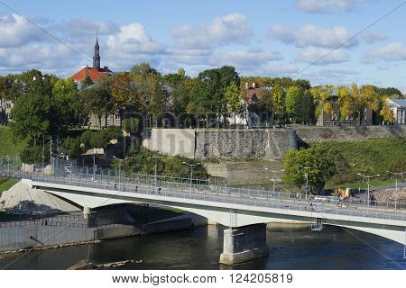NARVA, ESTONIA - SEPTEMBER 27, 2015: The border bridge between Estonia and Russia on the background of the city of Narva. The landmark of Narva