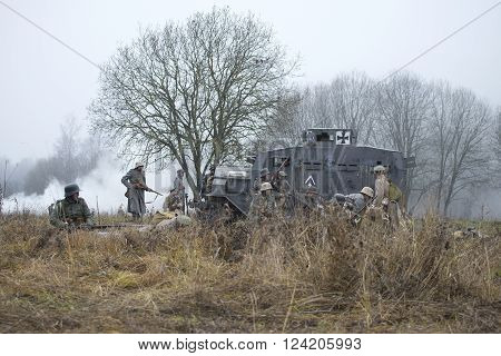 GATCHINA, RUSSIA - NOVEMBER 07, 2015: German soldiers during the First world war are preparing to attack under the cover of an armoured car