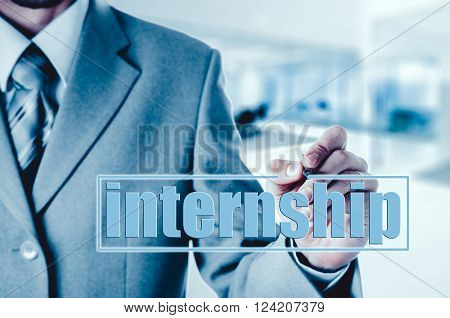 Businessman drawing an Internship concept on the background of the office.
